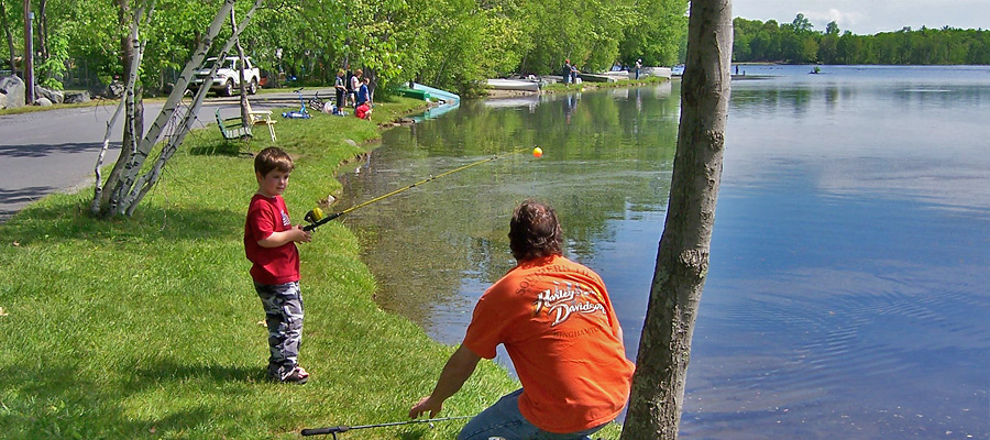 Fishing off the shore, father and son, at Otter Lake Camp  Resort